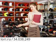 Young seller holding advertising brochure. Стоковое фото, фотограф Яков Филимонов / Фотобанк Лори