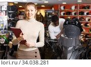 Adult seller holding advertising brochure. Стоковое фото, фотограф Яков Филимонов / Фотобанк Лори