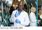 Купить «Man working at milking line», фото № 34038289, снято 8 августа 2018 г. (c) Яков Филимонов / Фотобанк Лори