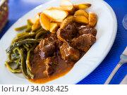 Купить «Beef stew with green beans and potatoes», фото № 34038425, снято 5 июля 2020 г. (c) Яков Филимонов / Фотобанк Лори