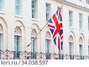 Купить «British flags flying on the balcony of a historic building in London», фото № 34038597, снято 20 августа 2017 г. (c) Nataliia Zhekova / Фотобанк Лори