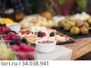 Купить «Wedding catering outdoor close up. food on buffet on wedding celebration», фото № 34038941, снято 28 июля 2018 г. (c) Юрий Голяк / Фотобанк Лори