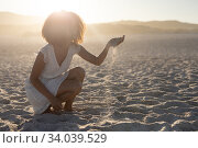 Купить «A mixed race woman enjoying free time on beach on a sunny day», фото № 34039529, снято 25 февраля 2020 г. (c) Wavebreak Media / Фотобанк Лори
