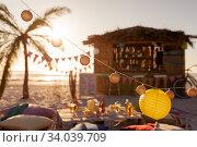 Купить «Blanket and cushions and a hut on beach», фото № 34039709, снято 25 февраля 2020 г. (c) Wavebreak Media / Фотобанк Лори