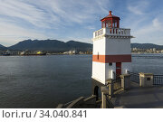 Купить «The lighthouse at Brockton Point in Stanley Park overlooks the harbour on Burrard Inlet, Vancouver, BC, Canada.», фото № 34040841, снято 28 мая 2020 г. (c) age Fotostock / Фотобанк Лори