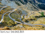 View to Transfagarasan road. It is a paved mountain road crossing the southern section of the Carpathian Mountains of Romania. It has national-road ranking... Стоковое фото, фотограф Zoonar.com/Serghei Starus / easy Fotostock / Фотобанк Лори
