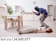 Купить «Gangster and young woman in robbery concept», фото № 34045977, снято 15 мая 2019 г. (c) Elnur / Фотобанк Лори