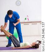 Купить «Fitness instructor helping sportsman during exercise», фото № 34046137, снято 10 июля 2018 г. (c) Elnur / Фотобанк Лори