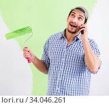 Купить «Young painter doing renovation at home», фото № 34046261, снято 2 мая 2018 г. (c) Elnur / Фотобанк Лори