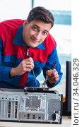 Computer technician repairing broken computer in workshop. Стоковое фото, фотограф Elnur / Фотобанк Лори