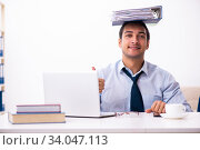 Купить «Young male employee working from house», фото № 34047113, снято 30 октября 2019 г. (c) Elnur / Фотобанк Лори