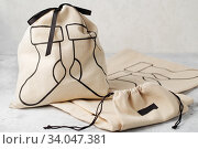 Canvas bag with drawstring, mockup of small eco sack made from natural cotton fabric. Стоковое фото, фотограф Nataliia Zhekova / Фотобанк Лори