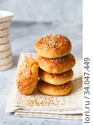 Купить «bun buns with sesame seeds on a wooden board.», фото № 34047449, снято 10 апреля 2020 г. (c) Nataliia Zhekova / Фотобанк Лори
