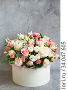 Купить «Bouquet of beautiful flowers with peonies, roses and eustomas in the papper gift box in front of grey grunge background. Closeup picture. Valentine's Day. Mothers Day», фото № 34047605, снято 1 февраля 2020 г. (c) Nataliia Zhekova / Фотобанк Лори