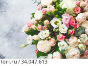 Купить «Bouquet of beautiful flowers with peonies, roses and eustomas in the papper gift box in front of grey grunge background. Closeup picture. Valentine's Day. Mothers Day», фото № 34047613, снято 1 февраля 2020 г. (c) Nataliia Zhekova / Фотобанк Лори