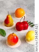 Купить «Mousse dessert in the shape of a pear fruit, orange fruit, apricot, lemon and cherry.», фото № 34047621, снято 1 февраля 2020 г. (c) Nataliia Zhekova / Фотобанк Лори