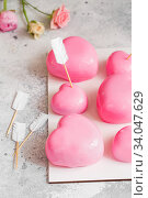 Купить «Pink Mousse dessert in the shape of hearts. Mousse cake for Valentine Day», фото № 34047629, снято 1 февраля 2020 г. (c) Nataliia Zhekova / Фотобанк Лори