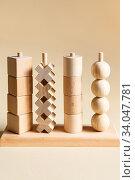 Купить «Children's wooden toys. Sequencing education Blocks, motor skills», фото № 34047781, снято 2 июня 2020 г. (c) Nataliia Zhekova / Фотобанк Лори