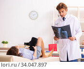 Male traumatologist looking at xray images. Стоковое фото, фотограф Elnur / Фотобанк Лори