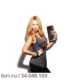 Купить «Fashion model girl portrait dressed in tight black pants, top and modern accessories», фото № 34048169, снято 13 марта 2016 г. (c) Nataliia Zhekova / Фотобанк Лори