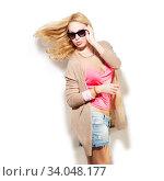 Fashion model girl portrait dressed in pink top, cardigan, denim shorts. Стоковое фото, фотограф Nataliia Zhekova / Фотобанк Лори