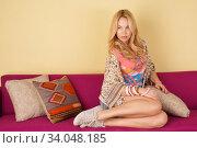 Купить «Beautiful cheerful woman on the sofa», фото № 34048185, снято 13 марта 2016 г. (c) Nataliia Zhekova / Фотобанк Лори