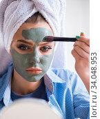 Купить «Woman applying clay mask with brush at home», фото № 34048953, снято 29 января 2018 г. (c) Elnur / Фотобанк Лори