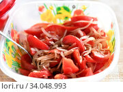 Купить «tomatoes and onion salad», фото № 34048993, снято 13 июня 2020 г. (c) Знаменский Олег / Фотобанк Лори