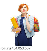 portrait of a funny emotional red-haired girl making amazedly round eyes isolated on white background. Стоковое фото, фотограф Nataliia Zhekova / Фотобанк Лори