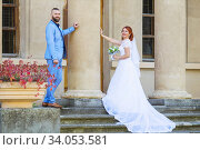 Купить «Just married loving hipster couple in wedding dress and suit in the park. Happy bride and groom walking running and dancing. Romantic Married young family.», фото № 34053581, снято 5 октября 2018 г. (c) Nataliia Zhekova / Фотобанк Лори