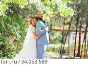 Купить «Just married loving hipster couple in wedding dress and suit in the park. Happy bride and groom walking running and dancing. Romantic Married young family.», фото № 34053589, снято 5 октября 2018 г. (c) Nataliia Zhekova / Фотобанк Лори
