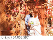 Купить «Just married loving hipster couple in wedding dress and suit in the park. Happy bride and groom walking running and dancing. Romantic Married young family», фото № 34053597, снято 5 октября 2018 г. (c) Nataliia Zhekova / Фотобанк Лори