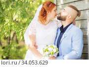 Купить «Just married loving hipster couple in wedding dress and suit in the park. Happy bride and groom walking running and dancing. Romantic Married young family.», фото № 34053629, снято 5 октября 2018 г. (c) Nataliia Zhekova / Фотобанк Лори