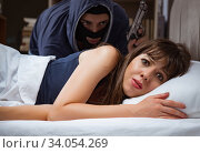 Купить «Burglar breaking into house at night to bedroom with sleeping wo», фото № 34054269, снято 9 августа 2017 г. (c) Elnur / Фотобанк Лори