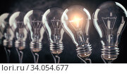 Row of light bulb with a one glowing. Idea and innovation concept. Стоковое фото, фотограф Maksym Yemelyanov / Фотобанк Лори