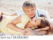 Купить «happy young couple enjoying picnic on the beach and have good time on summer», фото № 34054861, снято 6 сентября 2014 г. (c) Nataliia Zhekova / Фотобанк Лори