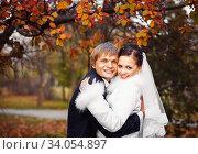 Купить «Photo of happy newlyweds outdoors.», фото № 34054897, снято 1 ноября 2014 г. (c) Nataliia Zhekova / Фотобанк Лори