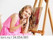 Купить «Portrait of a lovely little girl painting a picture in a studio or art school», фото № 34054981, снято 15 мая 2016 г. (c) Nataliia Zhekova / Фотобанк Лори