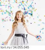 Купить «Happy excited laughing kid under sparkling confetti shower», фото № 34055045, снято 15 мая 2016 г. (c) Nataliia Zhekova / Фотобанк Лори