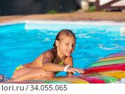 Купить «Little girl playing and having fun in swimming pool with air mattress. Kid playing in water. Swimming concept. Girl swim in resort pool during summer», фото № 34055065, снято 8 августа 2016 г. (c) Nataliia Zhekova / Фотобанк Лори