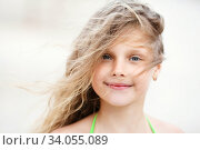Close-up Portrait of a pretty smiling little girl with waving in the wind long hair. Стоковое фото, фотограф Nataliia Zhekova / Фотобанк Лори