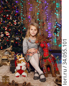 Little girl waiting for a miracle in Christmas decorations. Стоковое фото, фотограф Nataliia Zhekova / Фотобанк Лори