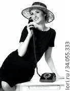 Купить «Portrait of a beautiful brown-eyed woman in a hat with a vintage telephone», фото № 34055333, снято 28 апреля 2014 г. (c) Nataliia Zhekova / Фотобанк Лори