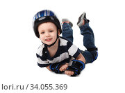little boy in protective gear fell off his bicycle or scooter or skateboard or roller-skates isolated on white background. Стоковое фото, фотограф Nataliia Zhekova / Фотобанк Лори