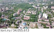 Aerial panoramic view of modern cityscape of Voskresensk overlooking Church of Icon of Mother of God of Jerusalem, Russia. Стоковое видео, видеограф Яков Филимонов / Фотобанк Лори