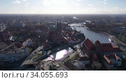 Купить «Aerial view of island of Ostrow Tumski in Wroclaw with Cathedral of St. John the Baptist on sunny spring day», видеоролик № 34055693, снято 14 марта 2020 г. (c) Яков Филимонов / Фотобанк Лори