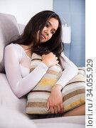 Купить «Gloomy teenager girl with pillow», фото № 34055929, снято 30 мая 2017 г. (c) Яков Филимонов / Фотобанк Лори