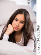 young female sad and thinking on sofa. Стоковое фото, фотограф Яков Филимонов / Фотобанк Лори