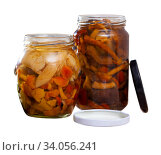 Купить «Tasty canned assorted mushrooms at glass jar, nobody», фото № 34056241, снято 2 июля 2020 г. (c) Яков Филимонов / Фотобанк Лори