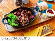 Grilled sausages with onions. Стоковое фото, фотограф Яков Филимонов / Фотобанк Лори